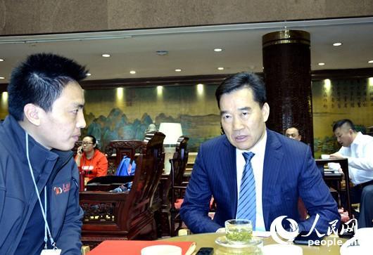 3月4日,全国人大代表、明阳新能源投资控股集团董事长张传卫接受人民网记者专访