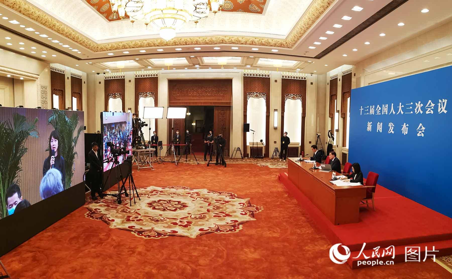 十三届全国人大三次会议发布会现场。人民日报、人民网记者  雷声/摄